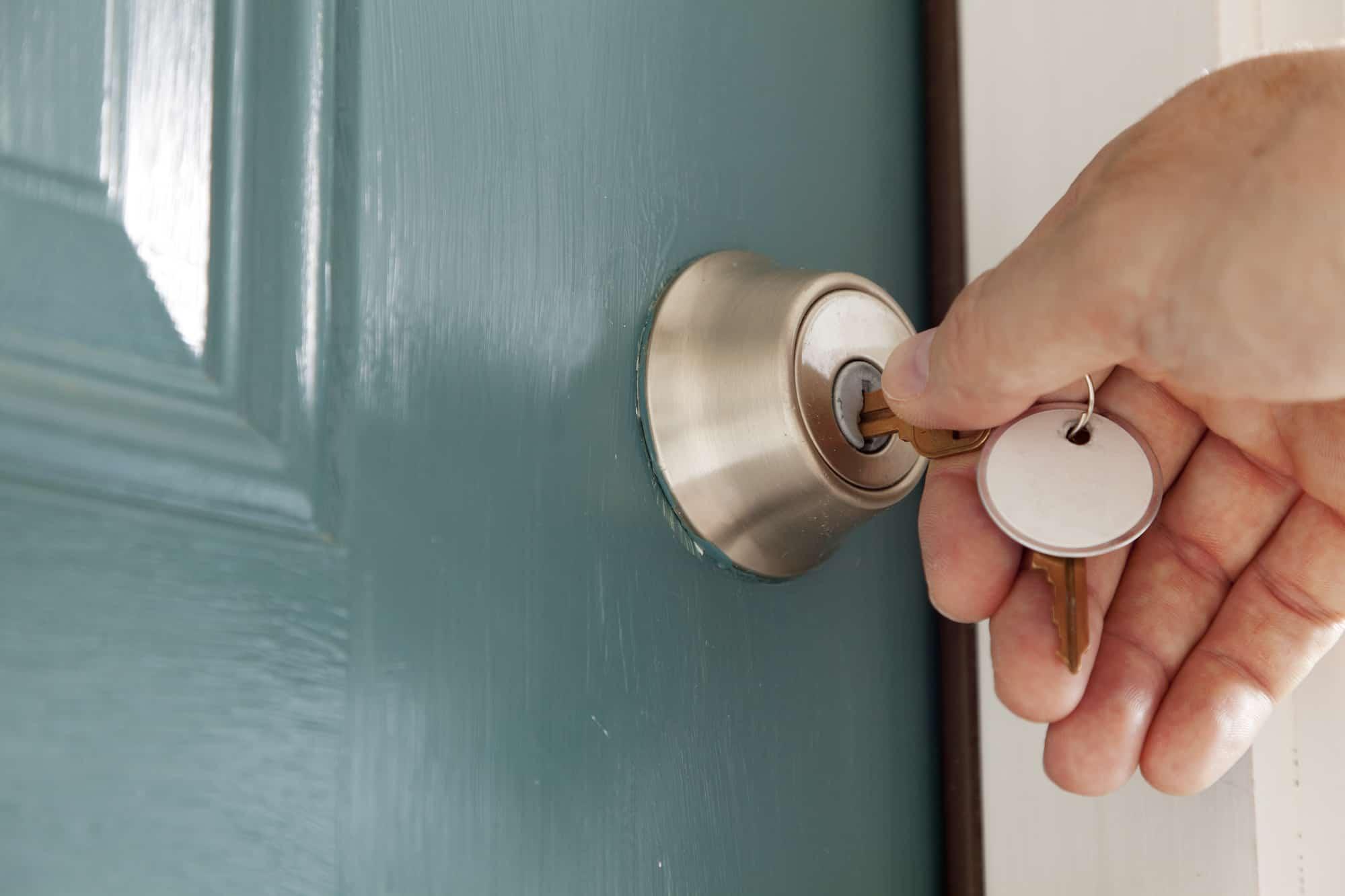 hand unlocking a door